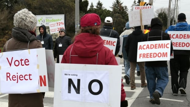 Pickets march near the entrance to Algonquin College on Tuesday, as the Ontario college strike enters its fifth week. Several instructors said they are confident that workers will overwhelmingly reject their employers' latest offer.