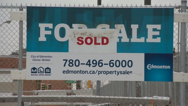 With a fence surrounding a 12-metre hole, the lot at 95th Street and Jasper Avenue was abandoned by the previous developer.