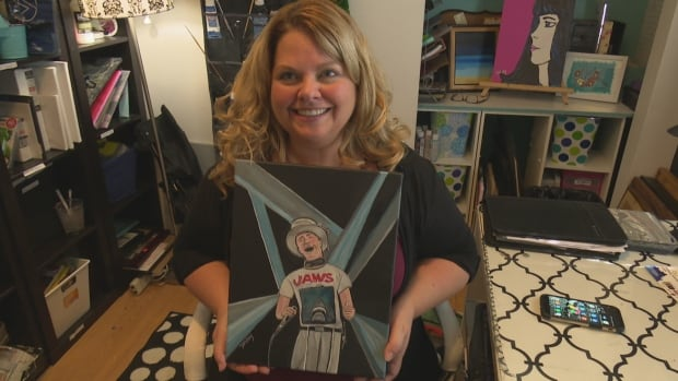 Windsor artist Debbie Kay with her portrait of the late Tragicall Hip frontman Gord Downie.