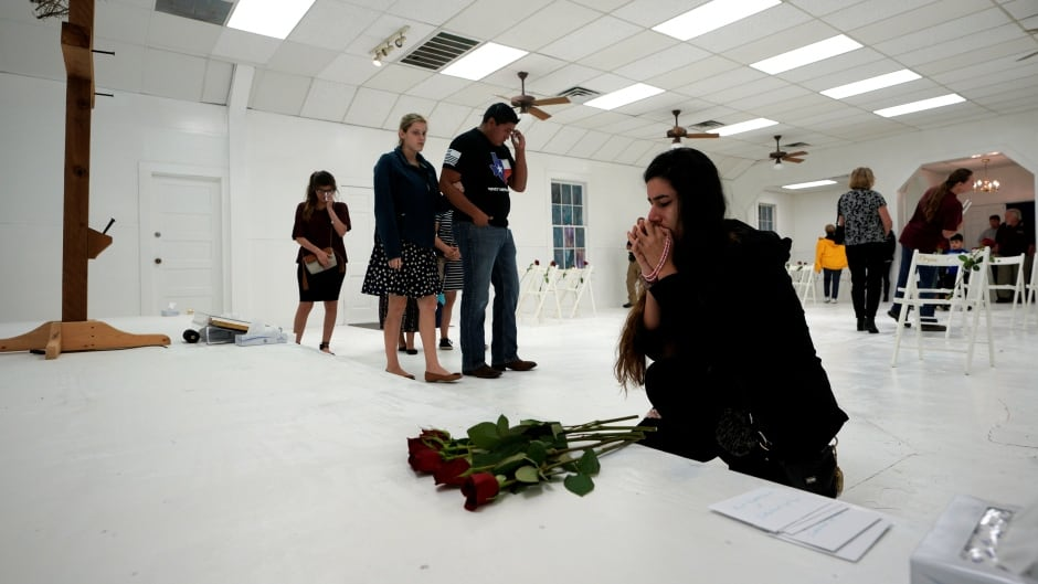 People pray in the First Baptist Church of Sutherland Springs, which was the site of a mass shooting last week, as the church was opened to the public as a memorial to those killed.