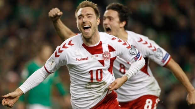 Denmark's Christian Eriksen celebrates after scoring his side's third goal during the World Cup qualifying second-leg soccer match between Ireland and Denmark on Tuesday.