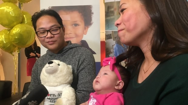 Baby Eiko, now almost three months old, with her parents, Romeo Crisostomo and Romeila Son, on Tuesday at a news conference in Toronto.