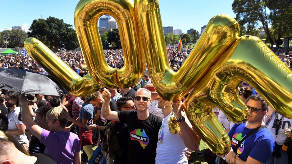 Supporters of the same-sex marriage gather to celebrate the announcement in a Sydney park on November 15, 2017.