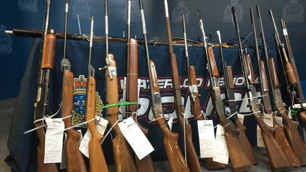 Rifles collected by the Waterloo Regional Police through their firearms and prohibited weapons amnesty program.  Owners will now get a grace period of up to six months once their gun license expires.