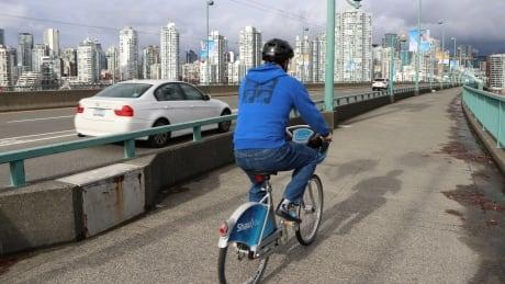 Cambie bridge cyclist
