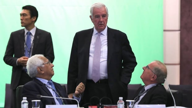 World Anti-Doping Agency (WADA) President Craig Reedie, center, talks with IOC member Robin Mitchell, left, and Drug-Free Sport New Zealand Board Chair Warwick Gendall, right, before the start of the WADA's foundation board meeting in Seoul, South Korea.