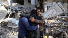 Iran Earthquake survivors mourn in front of destroyed houses