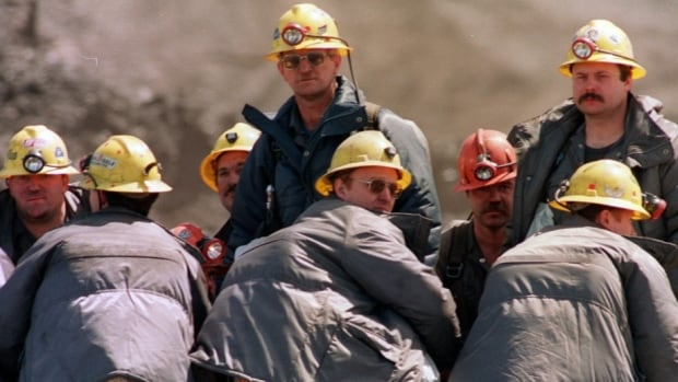 Rescue workers head to the entrance of the Westray coal mine in Plymouth, N.S., on May 12, 1992, after an explosion killed 26 men. This disaster set the stage for a national discussion about worker safety and changes to the Criminal Code.