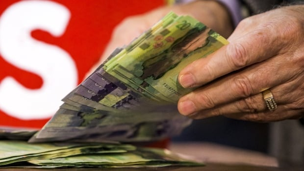 Cash may no longer be king for big purchases, but a majority of all transactions in Canada still happen with paper money, the Bank of Canada says.
