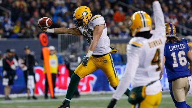The Edmonton Eskimos' Adarius Bowman (4) celebrates as Brandon Zylstra (83) leaps across for the touchdown against the Winnipeg Blue Bombers during a game in Winnipeg on Sunday, Nov. 12, 2017.