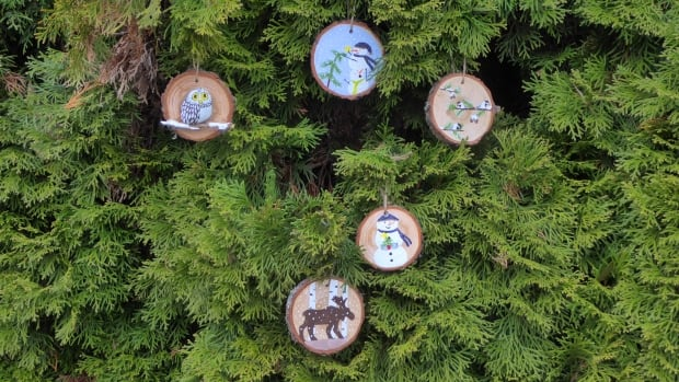 The hand-painted Christmas ornaments started showing up on trees in local parks in early November.
