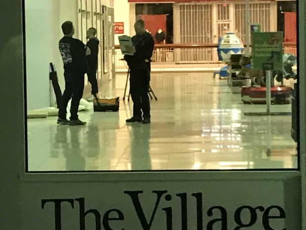 Police on the scene at the Village Mall