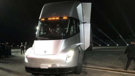 tesla unveils electric big rig truck record fast roadster