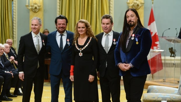 Julie Payette, Governor General of Canada, presents the insignia of the Order of Canada to members of the Tragically Hip Johnny Fay, left to right, Paul Langlois, Gord Sinclair and Rob Baker, at Rideau Hall in Ottawa on Friday Nov. 17, 2017.
