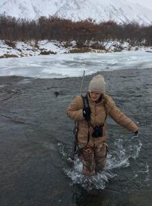 Cheryl Ritz crossing a creek