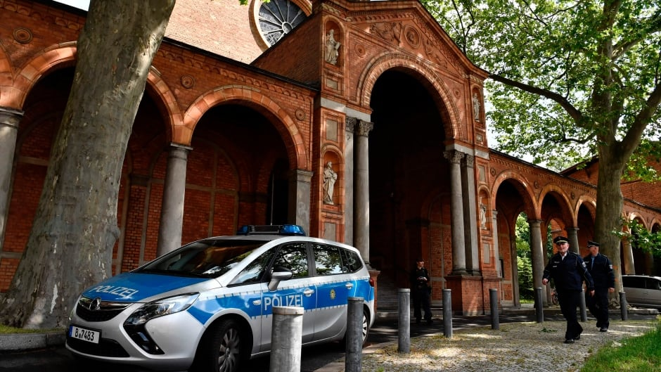 A police car is parked in front of the St. Johannis Protestant church which houses the Ibn Rushd-Goethe-mosque in Berlin