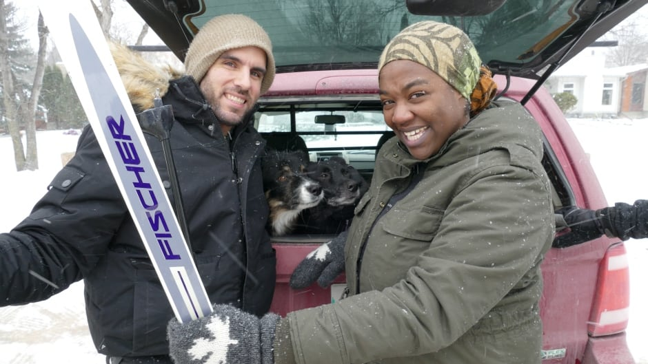 Winter warriors Trevor Dineen and Ify Chiwetelu, along with a pair of 'skijoring' dogs.