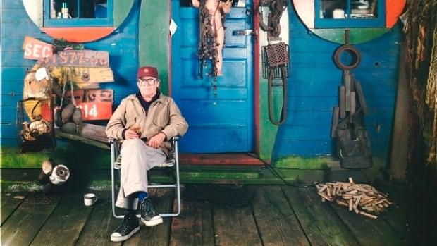 Photographer Jim Jardine captured Al Neil on the deck of the Blue Cabin near Cates Park in Dollarton.