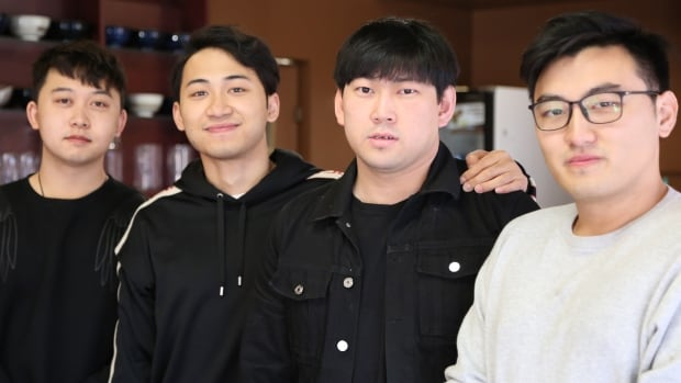 Liang Li, Yuhang He and Ming Hao (left to right) own Spoon Ramen in Windsor. Guanlin Zhu (right) is the chef.