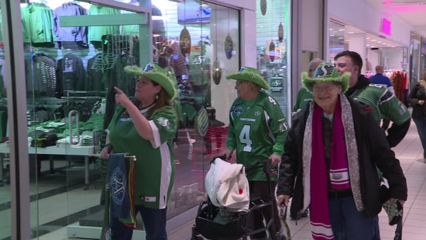 The Mongovius family walks past the Rider Store in Lawson Mall in Saskatoon. A few family members are headed to Toronto to watch the Roughriders face off against the Argonauts, Sunday.