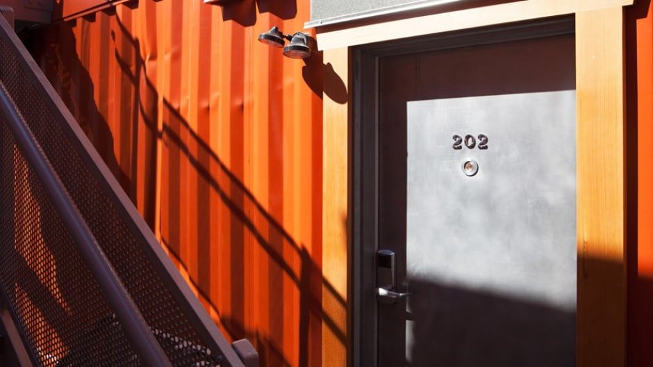 Oneesan's apartments are built in recycled shipping containers. Each one has its own door, which really matters to women who have been homeless or victims of violence.