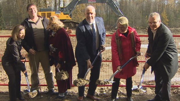 B.C. premier John Horgan breaks ground for a new mental health and addictions centre alongside other stakeholders on the Riverview lands in Coquitlam.