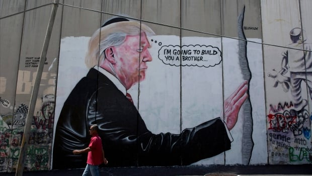 A mural on Israel's West Bank separation barrier, seen in this Aug. 4, 2017 photo, depicts U.S. President Donald Trump.