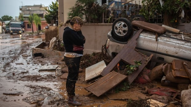 The flooding, caused by heavy rainfall, left widespread damage in Mandra, northwest of Athens.