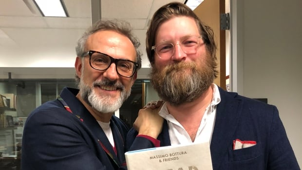 Jeremy Charles poses with Massimo Bottura, author of Bread is Gold.