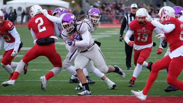 Western Mustangs running back Cedric Joseph runs for a touchdown against the Acadian Axemen during Uteck Bowl football action at Acadia University in Wolfville, N.S., on Saturday, Nov. 18, 2017.