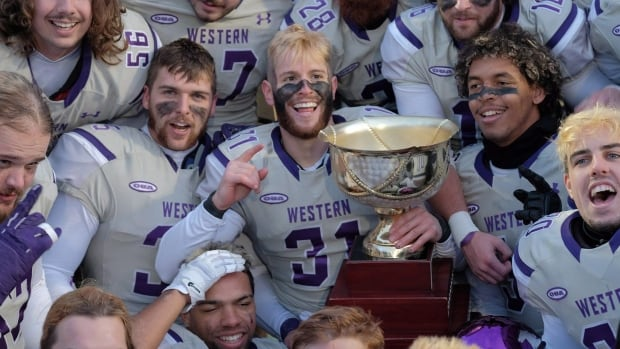 The Western Mustangs celebrate their 81-3 win over the Acadia Axemen in Uteck Bowl football action in Wolfville, N.S., on Nov. 18, 2017.