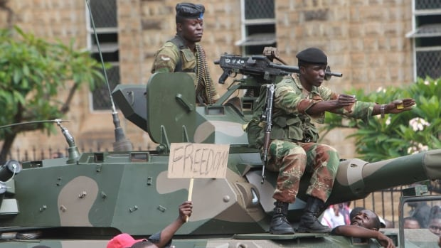 Soldiers on military tanks try to control a euphoric crowd marching on the streets of Harare, demanding the departure of President Robert Mugabe. The military put him on house arrest last week, and will meet with him tomorrow.