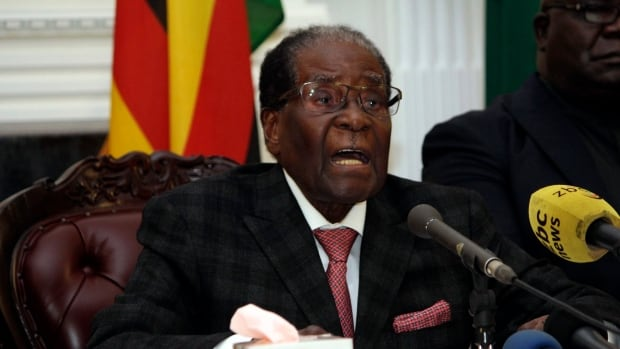 Zimbabwean President Robert Mugabe delivers his speech during a live broadcast at State House in Harare Sunday. Mugabe shocked the country by ending his address on national television without announcing his resignation.