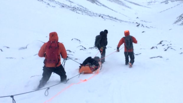 Kananaskis Public Safety crews take an injured skier from the scene of an avalanche on Saturday.