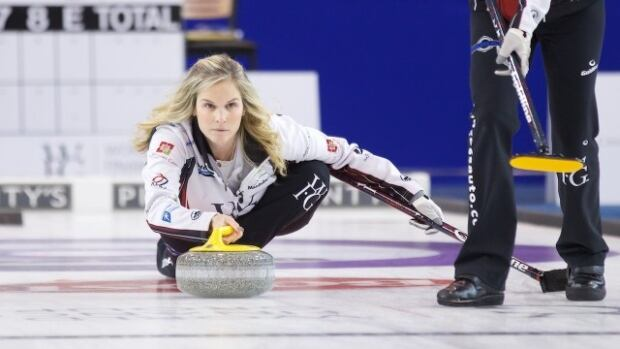 Jennifer Jones defeated Casey Scheidegger 8-7 to win the Grand Slam of Curling women's title on Sunday, in Sault Ste. Marie, Ont.