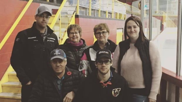 Braden Pettinger (bottom right) hopes to one day walk again and help young hockey players with their skills.