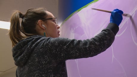 Artists paint murals in Edmonton LRT stations to promote diversity