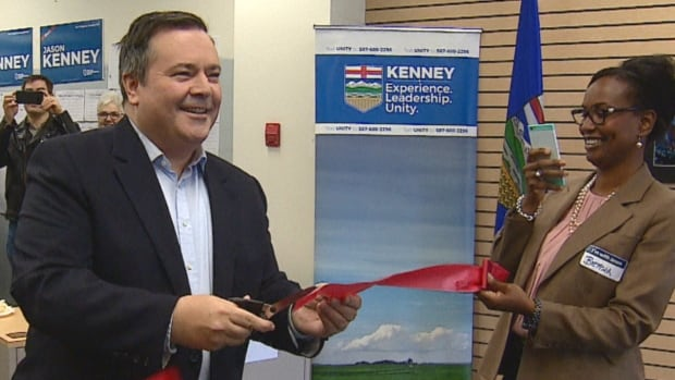 About 100 supporters were on-hand to watch Jason Kenney cut the red ribbon on his Calgary-Lougheed campaign office on Sunday.