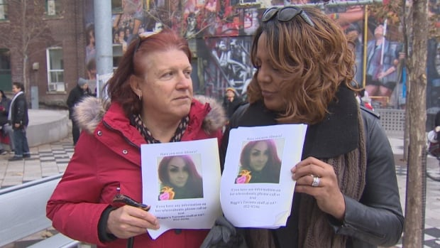 Nicki Ward, left, and Monica Forrester, right, were among a hundred people at a vigil and march for Alloura Wells in Toronto on Sunday ahead of Transgender Day of Remembrance.