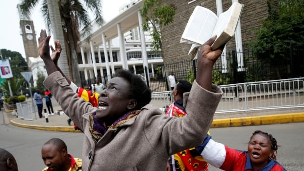 Supporters cheer Monday after Kenya's Supreme Court upheld the re-election of President Uhuru Kenyatta in last month's repeat presidential vote.