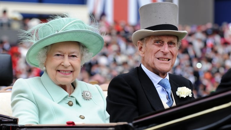 Queen Elizabeth II and her husband Prince Philip, the Duke of Edinburgh, arrive to attend Ladies Day at Royal Ascot race meeting, in Ascot, England on June 21, 2012. The royal couple are currently celebrating their 70th wedding anniversary.