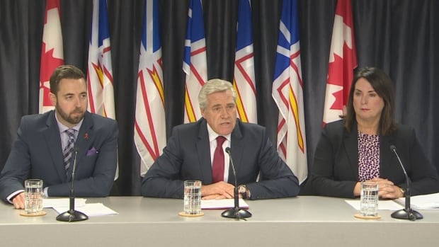Premier Dwight Ball is flanked by Justice Minister Andrew Parsons, left, and Natural Resources Minister Siobhan Coady as he announces terms for the Muskrat Falls judicial inquiry.