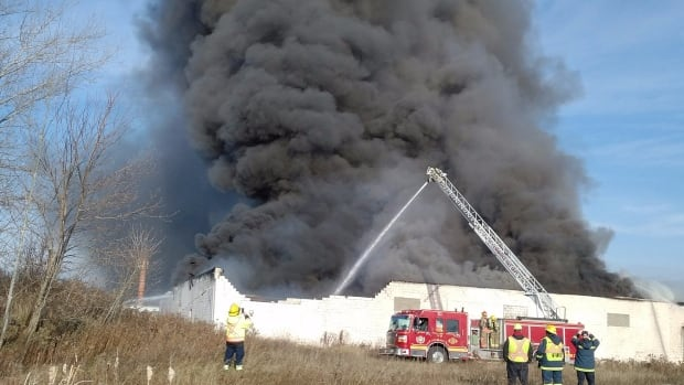 The city is warning residents to stay away from a fire at a factory on Sheffield Street in Cambridge.