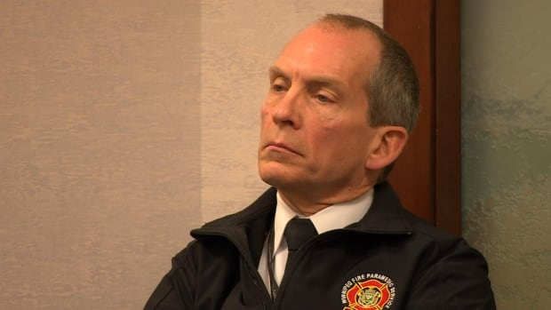 Winnipeg Fire Paramedic Service Chief John Lane listens to the closing arguments at an arbitration hearing where the paramedics' union accused him of unfairly favouring firefighters.