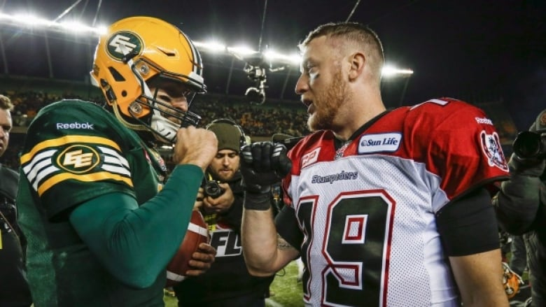 Eskimos fans still scratching their heads over questionable call mike reilly congratulates bo levi mitchell after sundays 32 28 loss freerunsca Gallery