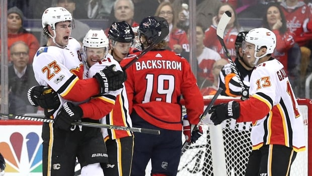 Calgary's Sean Monahan (23) celebrates his second-period goal, assisted by Johnny Gaudreau (13), in the Flames' 4-1 win in Washington on Monday.