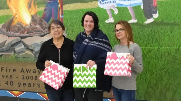 The Saskatoon Indian and Metis Friendship Centre will be a centre of support services for the MMWIG inquiry this week. May Henderson (left), Julie Kaye and Sara Adams hold up care bags for families.