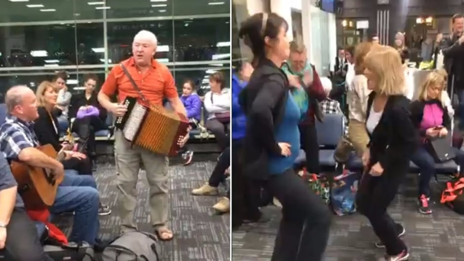 Musicians Sean Sullivan and Sheldon Thornhill helped get a group of Newfoundlanders and Labradorians up singing and dancing Monday evening at Pearson International Airport, when their WestJet flight was delayed by aboutr 30 minutes.