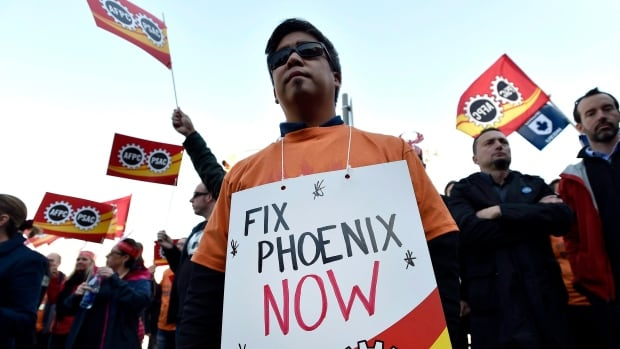 Public servants protest over problems with the Phoenix pay system outside the Office of the Prime Minister on Oct. 12, 2017. CUPE has filed an injunction in federal court to stop more RCMP civilian employees from being transferred to Phoenix.