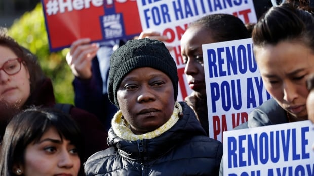 Immigration advocates rally in New York on Tuesday to protest the decision by the U.S. Department of Homeland Security to terminate Temporary Protected Status for people from Haiti.